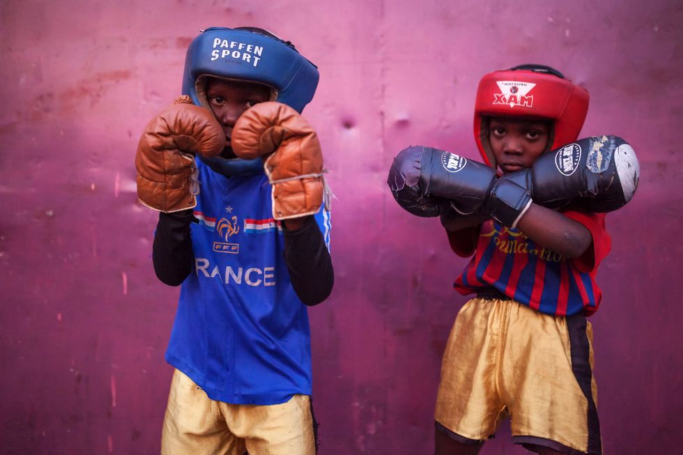 Two kids in their boxing gear.