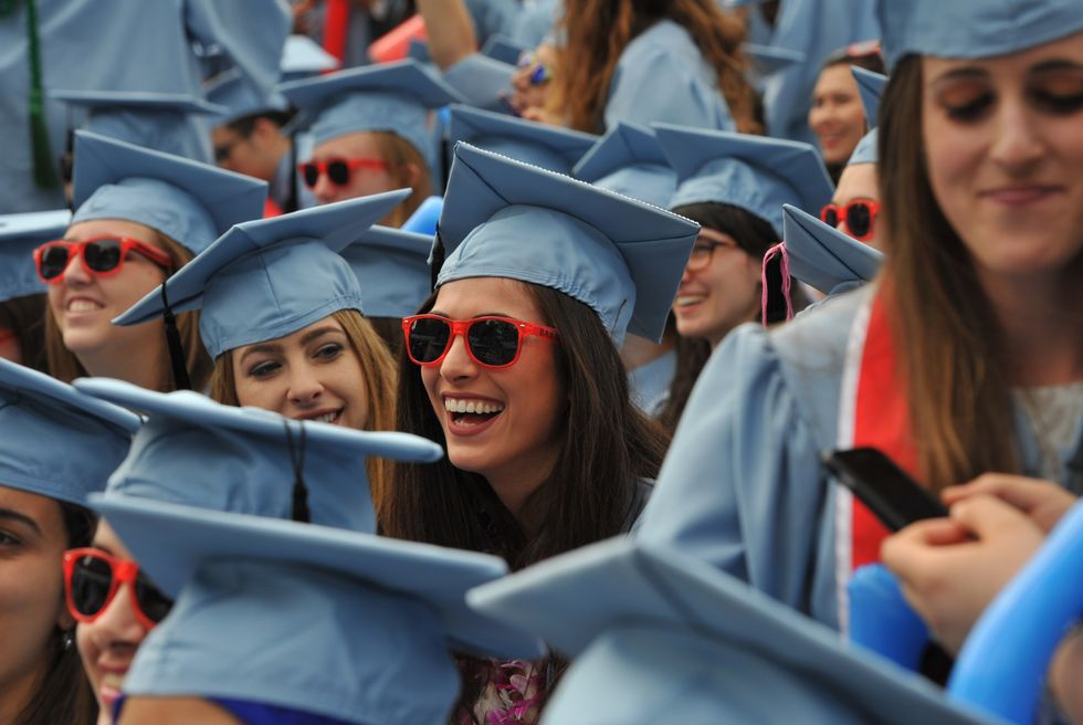 Plenty of reasons to smile for these Liberal Arts students, graduating from Barnard College during the Columbia University 2016 Commencement ceremony in New York May 18, 2016.