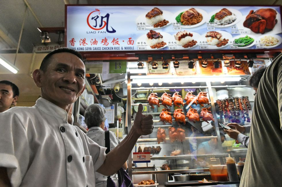 Singaporean chef Chan Hon Meng poses in front of his Hong Kong Soya Sauce Chicken Rice and Noodle stall in Singapore. (Photo credit ROSLAN RAHMAN/AFP/Getty Images)