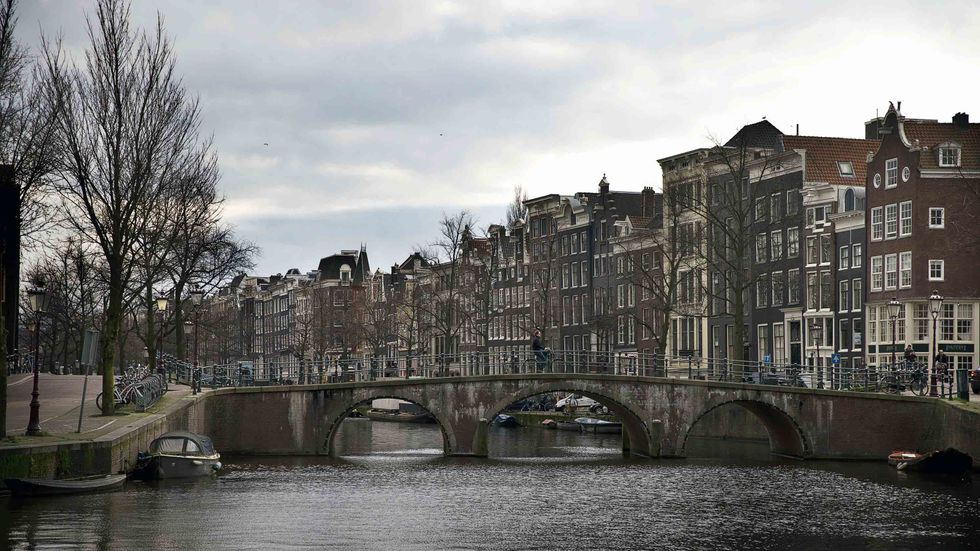 Keizersgracht, one of the city of Amsterdam's three main canals. (Photo credit should read JERRY LAMPEN/AFP/Getty Images)