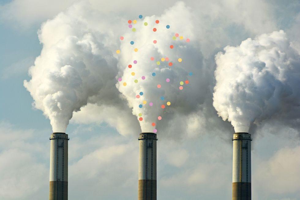 A fossil fuel factory spewing out a flume of confetti, instead of carbon dioxide.