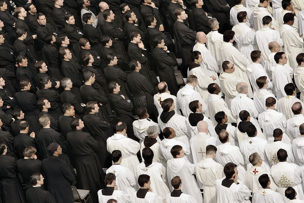 Priests attend a special mass for Pope John Paul II in St Peter's Square on April 3, 2005, in Vatican City. (Photo by Peter Macdiarmid/Getty Images)