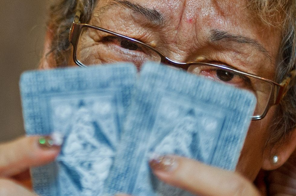 Sylvia Quintero, an astrologist and Tarot card reader, shares her visions on politics and the future. (Photo: PAUL J. RICHARDS/AFP/GettyImages)