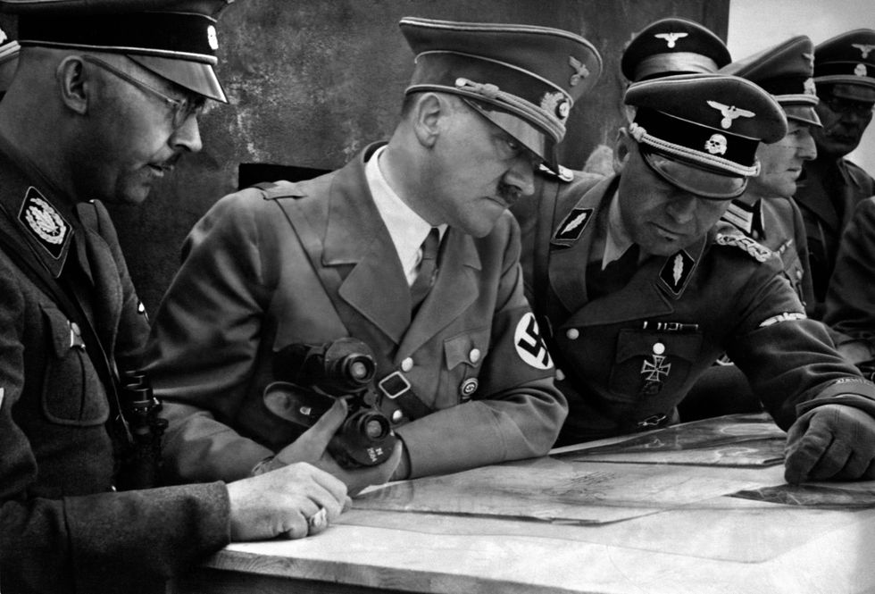 Hitler deciding strategy with his generals around him.