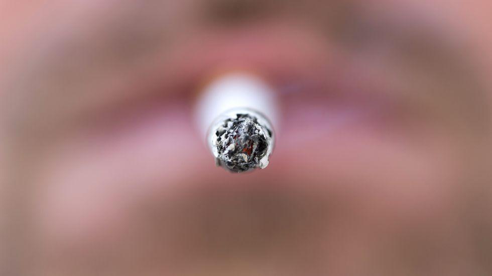 A man smokes a cigarette. (Photo: KENZO TRIBOUILLARD/AFP/Getty Images)