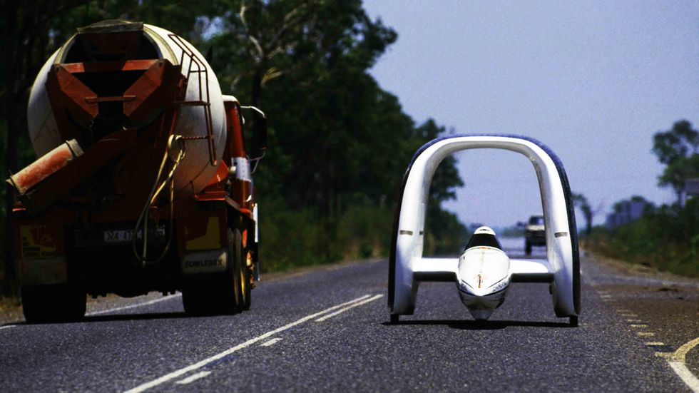 A solar-powered car designed by Jonathan Tennyson drives on Stuart Highway during the inaugural Darwin to Adelaide Pentax World Solar Challenge race.