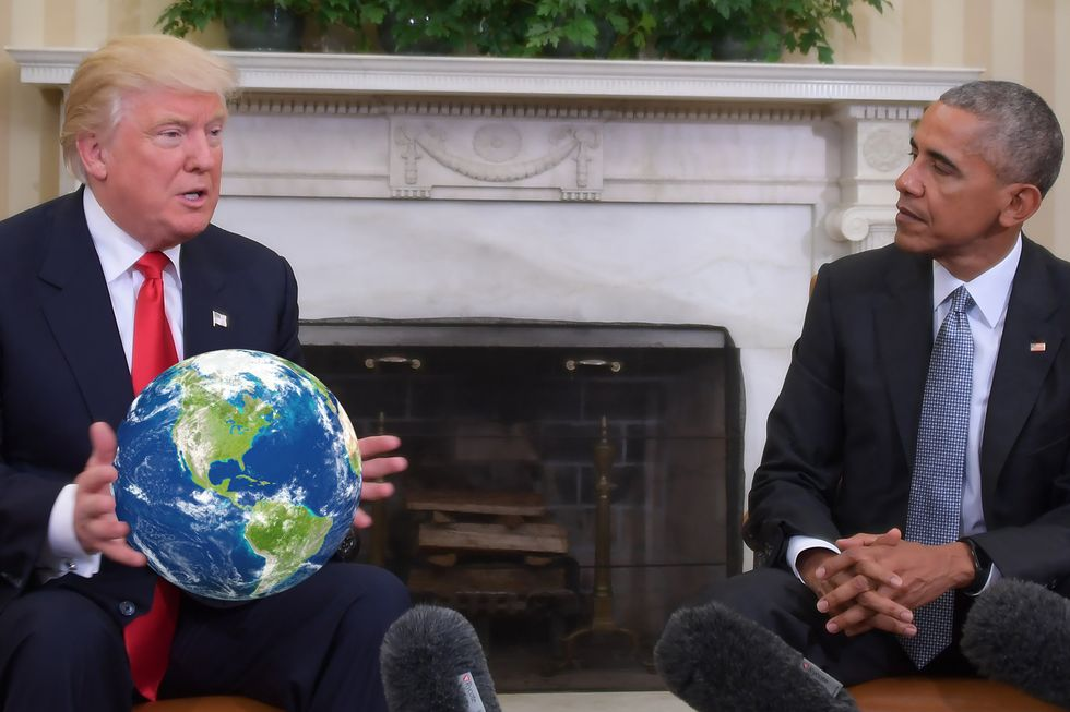 Donald Trump with the world in his hands.