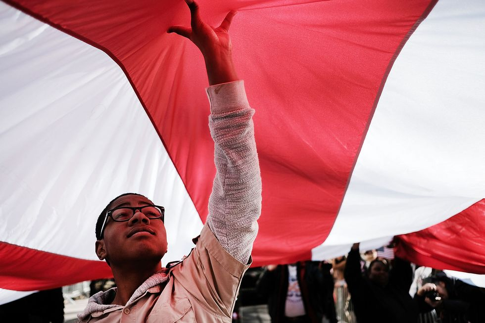 Boy Scout Anthony Tucker holds up an American Flag during the nation's largest Veterans Day Parade in New York City on November 11, 2016 in New York City. (Photo by Spencer Platt/Getty Images)