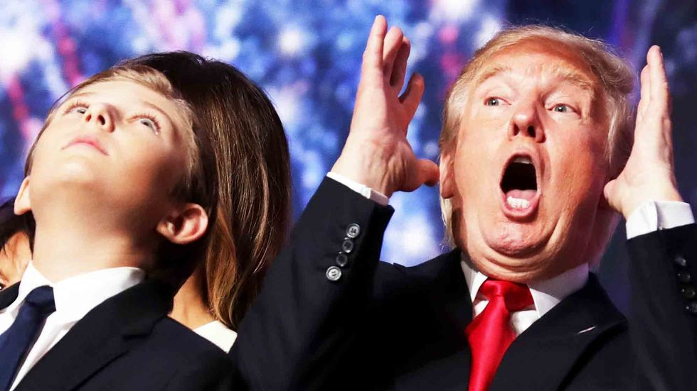 Donald Trump reacts as his son Barron Trump looks on. Photo by Chip Somodevilla/Getty Images