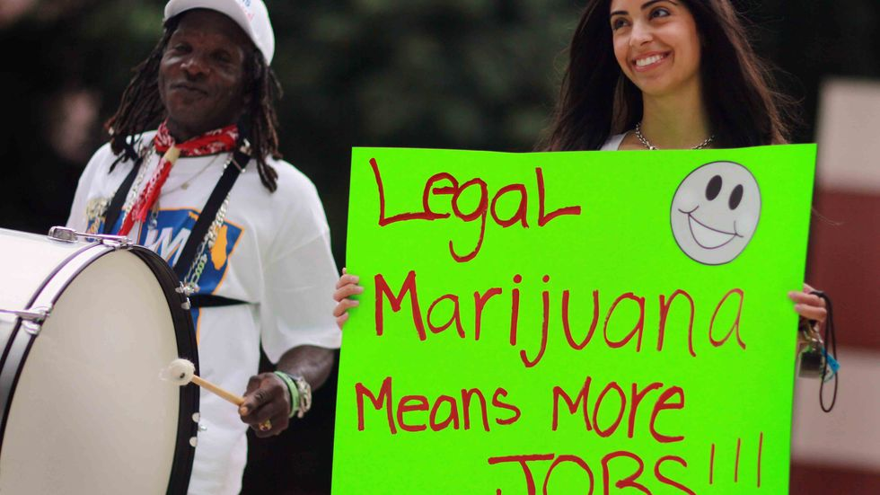 Marijuana activists attend a political rally. (Photo by Joe Raedle/Getty Images)