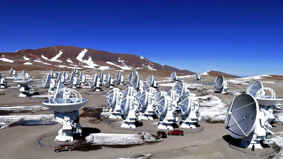 Aerial picture of Radio telescope antennas of the ALMA project in the Chajnantor plateau, Atacama desert, some 1500 km north of Santiago, Chile. (ARIEL MARINKOVIC/AFP/Getty Images)