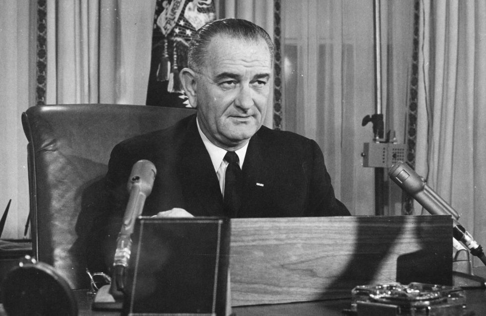 2nd December 1963: American President Lyndon Baines Johnson addresses the nation on his first thanksgiving day television programme, broadcast from the executive offices of the White House. (Photo by Keystone/Getty Images)