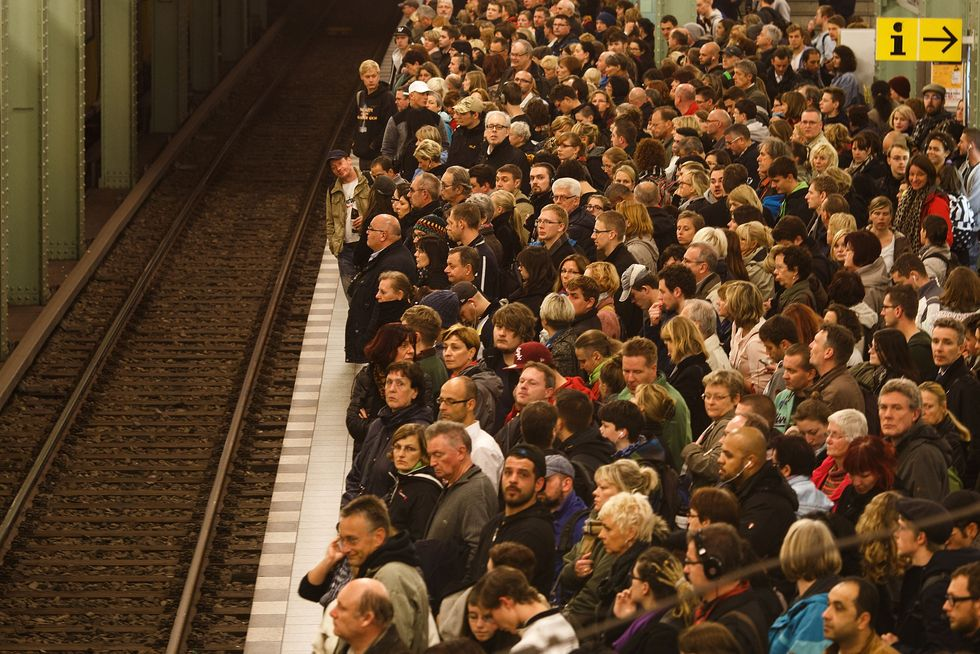 Passengers crowd the platform as they wait for the subway train. Photo by Carsten Koall/Getty Images