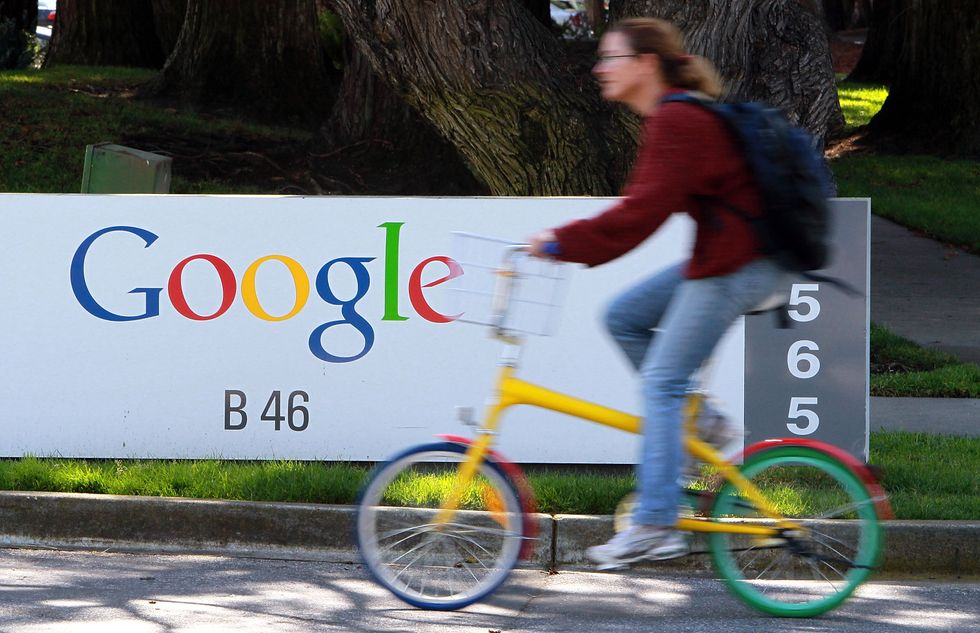 A cyclist pedals past the Google headquarters.