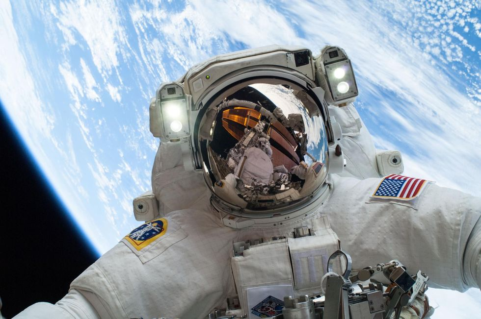 NASA astronaut Mike Hopkins, Expedition 38 flight engineer, participates in the second of two spacewalks, spread over a four-day period, which were designed to allow the crew to change out a faulty water pump on the exterior of the Earth orbiting Internat