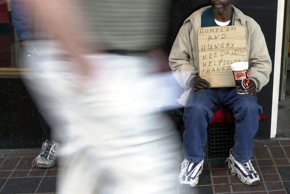 A homeless man panhandling in Cincinnati.
