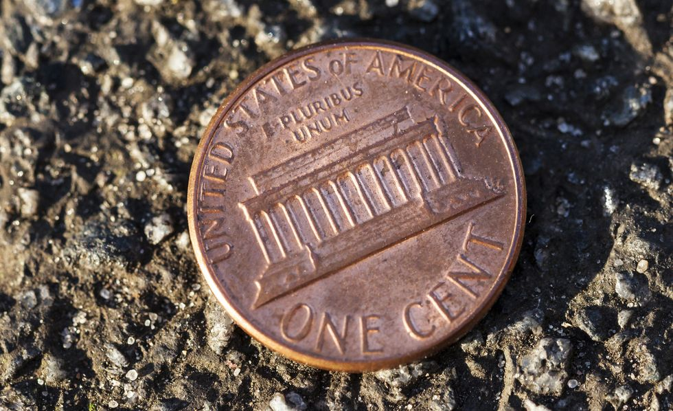 A penny on the ground.
