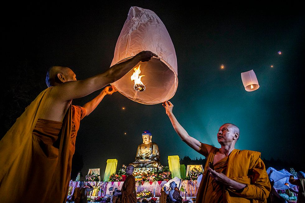 Buddhist monks release a lantern into the air at Borobudur temple during celebrations for Vesak Day. The holy day celebrates the birth, the enlightenment to nirvana, and the passing of Gautama Buddha's, the founder of Buddhism.