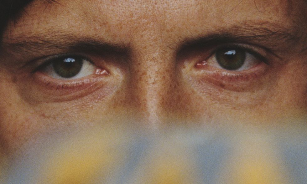 A set of eyes staring out at us.