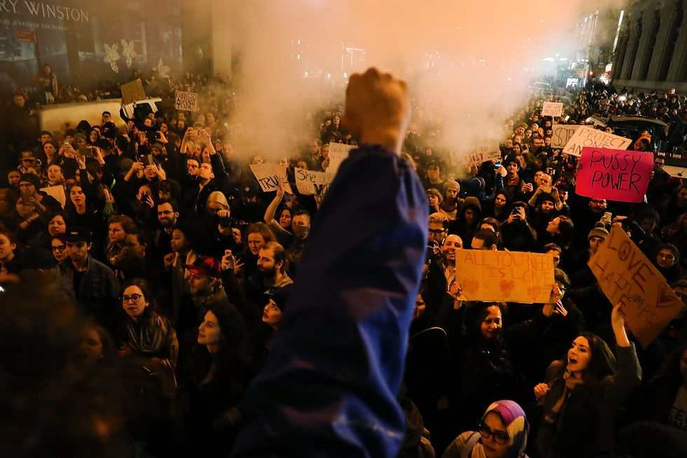 A protestor raises his fist in a power/defiance gesture during the protests that followed the 2016 US election results.