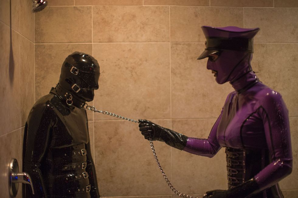 Two fetishists in rubber suits.