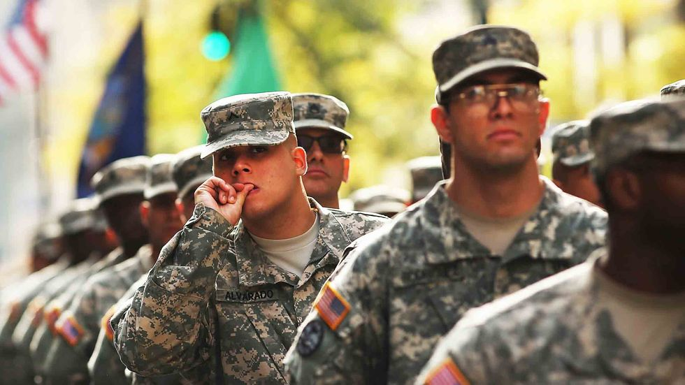 Soldiers with the U.S. Army march in the annual Veteran's Day Parade along Fifth Avenue on November 11, 2014 in New York City. (Photo by Spencer Platt/Getty Images)