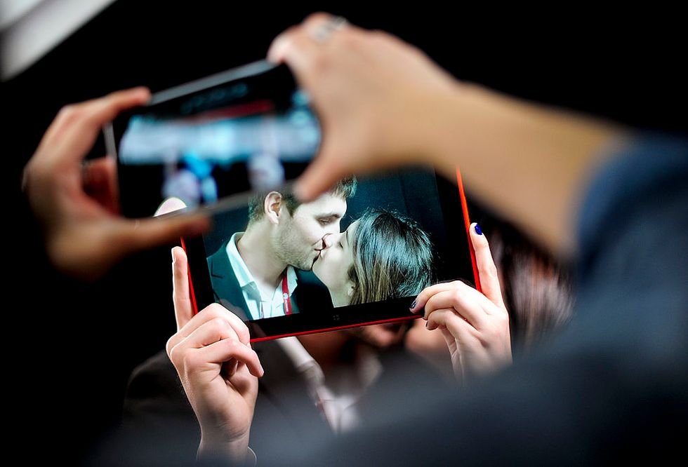 Couple seen through another screen. Credit: Getty Images