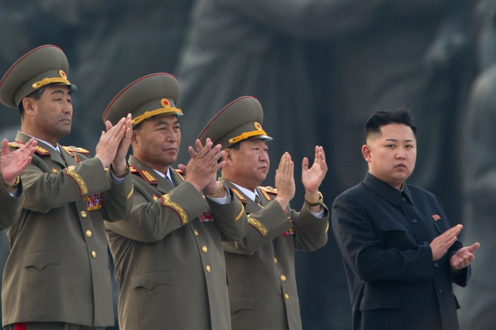 Kim Jong-un surrounded by generals.