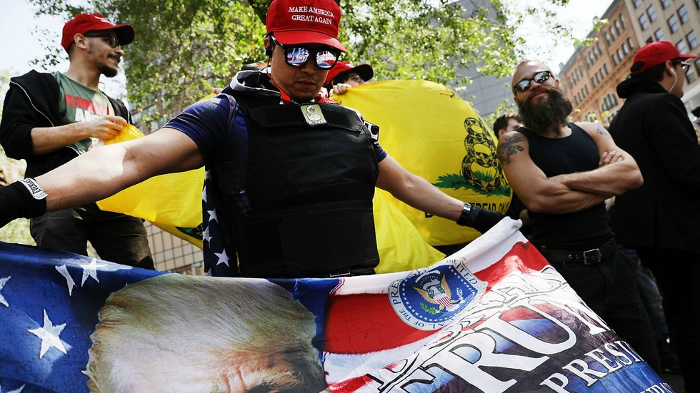 A Donald Trump supporter protests