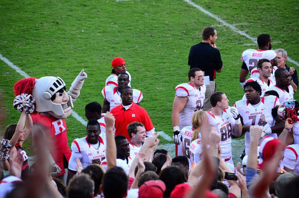 Mascot and Scarlet Knights at a football game