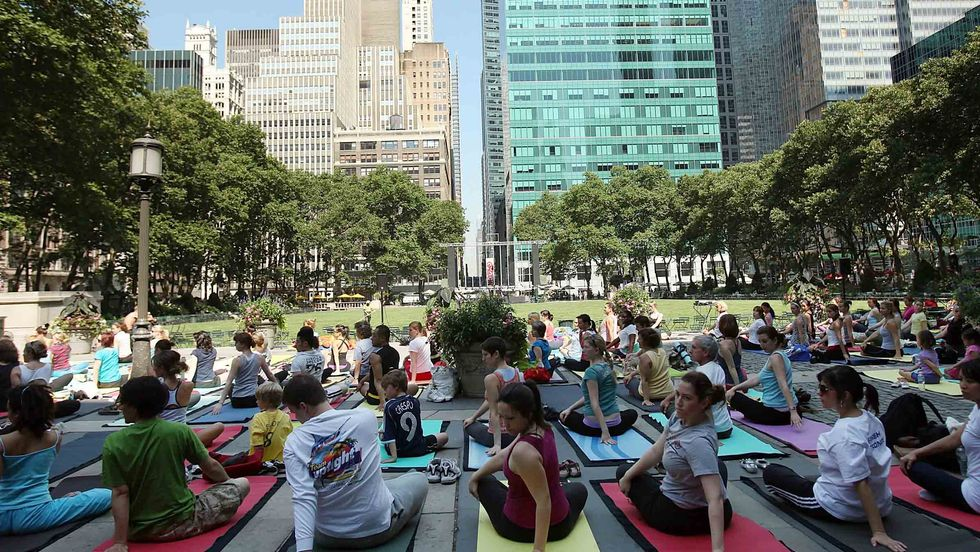 People participate in a free outdoor yoga class in Bryant Park in New York City. (Spencer Platt/Getty Images)