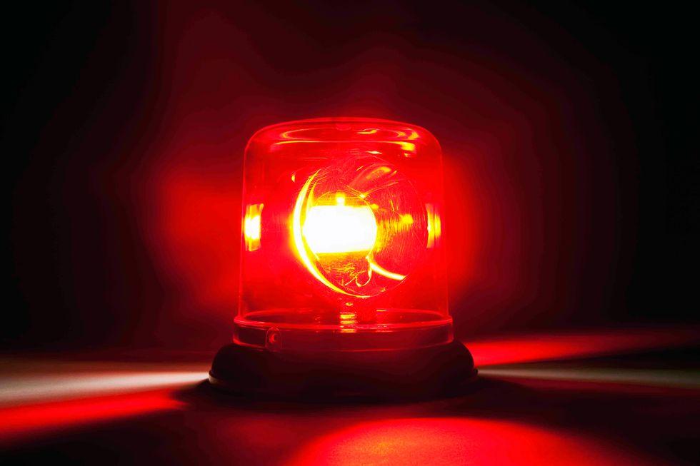A red emergency light. (Caspar Benson/Getty)