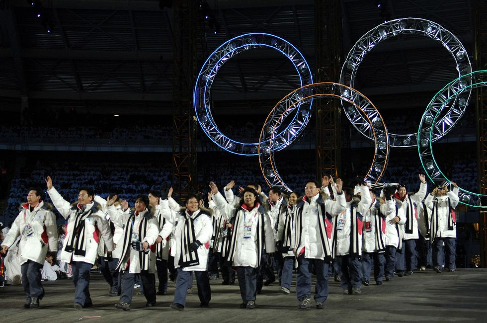 North and South Koreans march together at the 2006 Winter Olympics in Turin, Italy.
