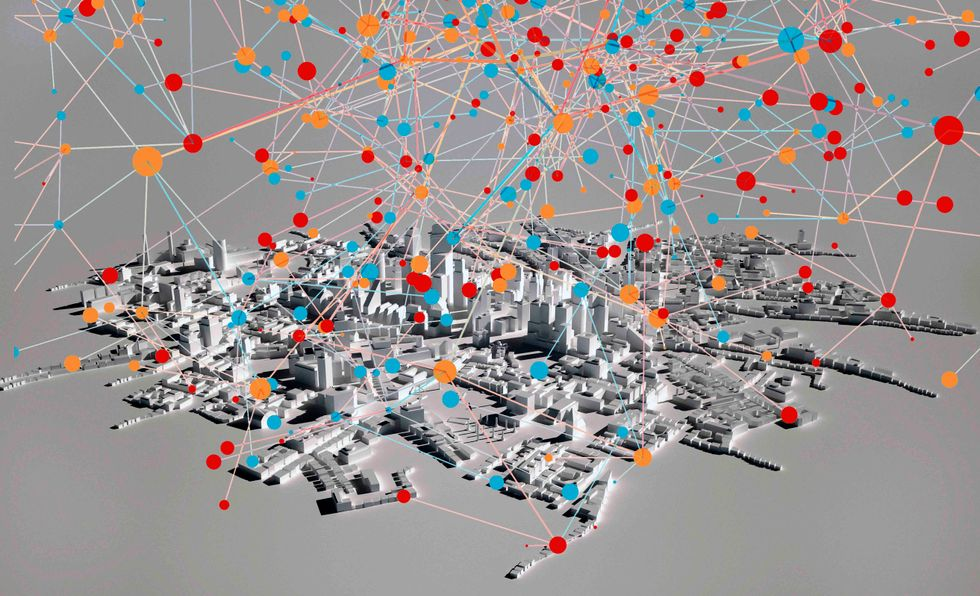 High angle view of cityscape model on gray background with data point overlay. (Getty/Big Think)