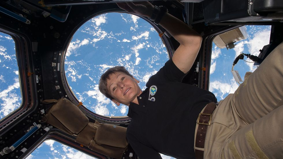 Astronaut Peggy Whitson against the backdrop of earth