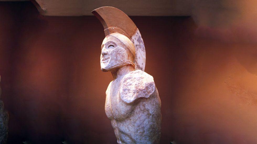 A statue of a greek solder