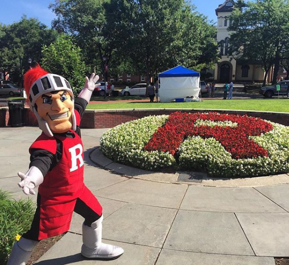 Scarlet Knight mascot holding his arms out