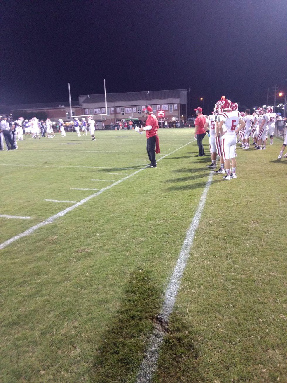 coach on the football field