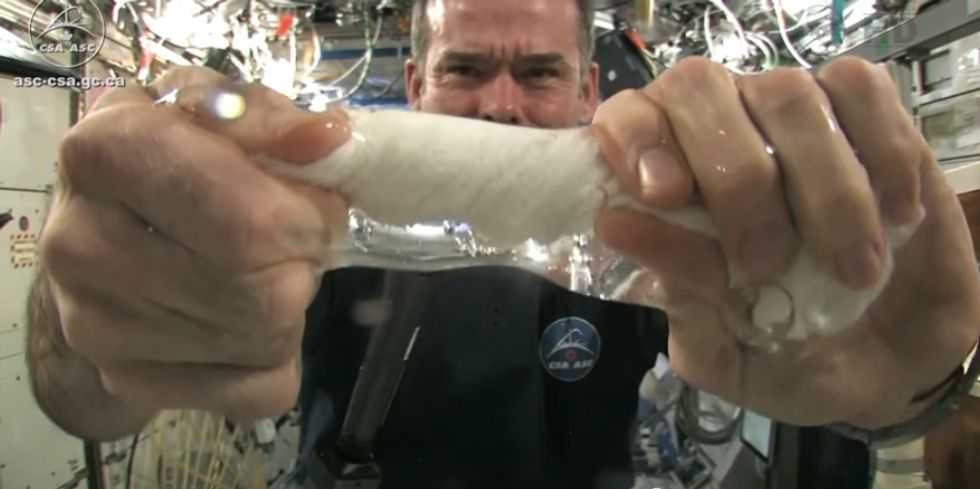Microgravity Experiment: Wringing a Wet Towel in Space