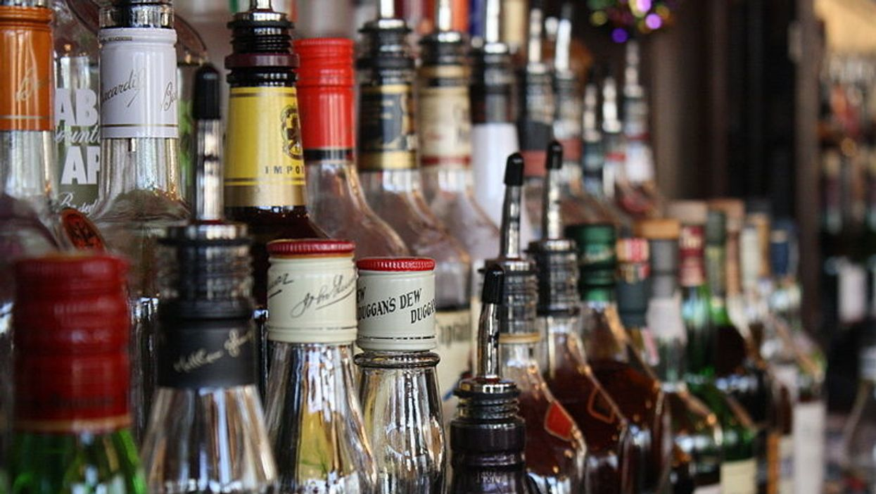 A collection of alcohol bottles at the bar.
