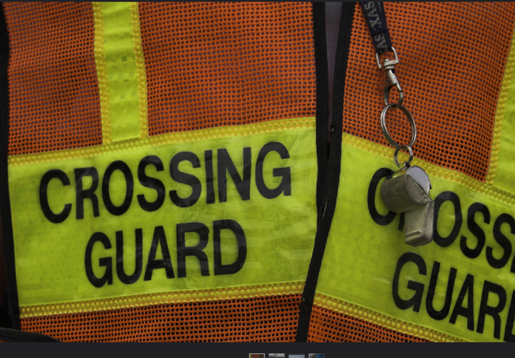 Flickr- Crossing guard with whistle