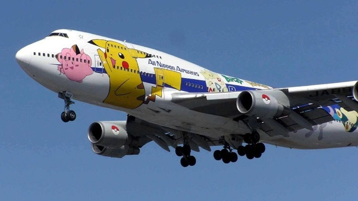 An ANA Boeing 747 decked out with Pokemon lands at London Heathrow.
