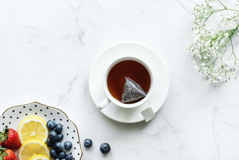 https://www.pexels.com/photo/flat-lay-photography-of-tea-in-white-teacup-with-saucer-990820/