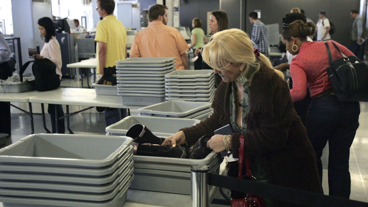 Airport security trays are dirtier than airport toilets, new study finds