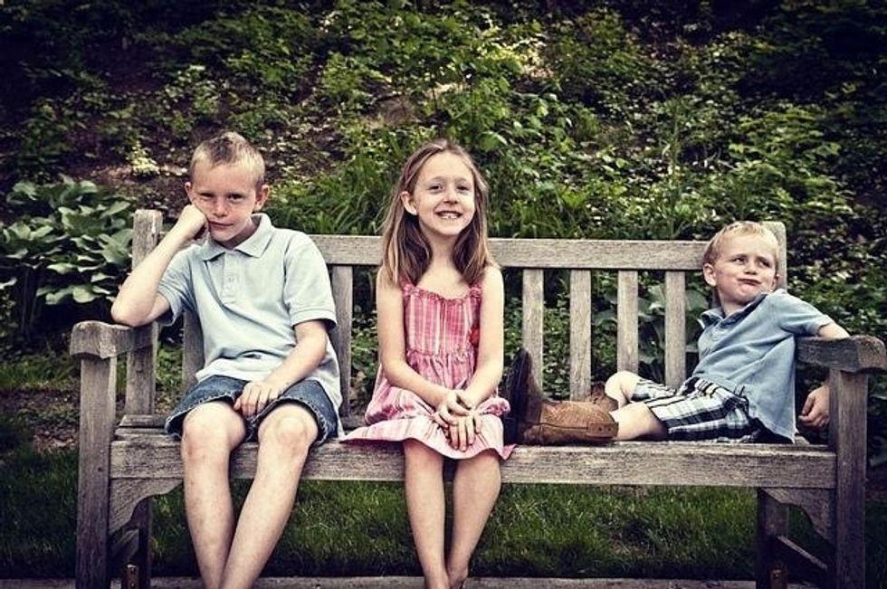 siblings on bench
