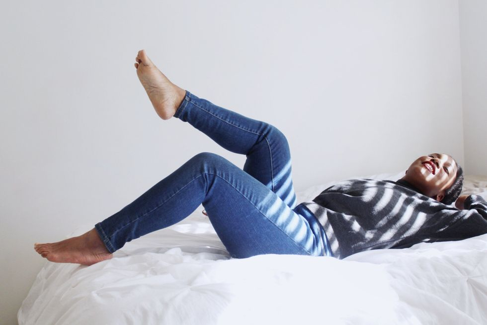 girl laying on a bed