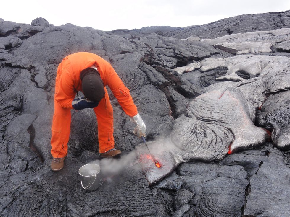 Watch Your Fingers! Geologist on Hawaiian Volcano Collects Lava Samples.