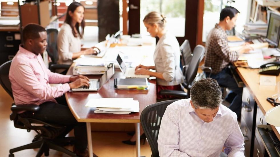 Open-Office Plans Distract, Demotivate, and Spread Illness