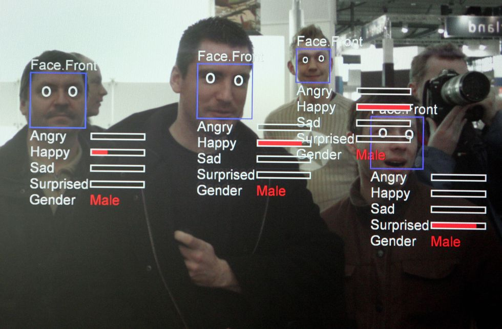 Men being scanned by facial recognition software.