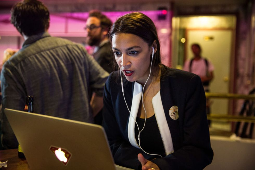 Alexandria Ocasio-Cortez celebrates at a victory party in the Bronx after upsetting incumbent Democratic Representative Joseph Crowley on June 26, 2018 in New York City.(Photo by Scott Heins/Getty Images)